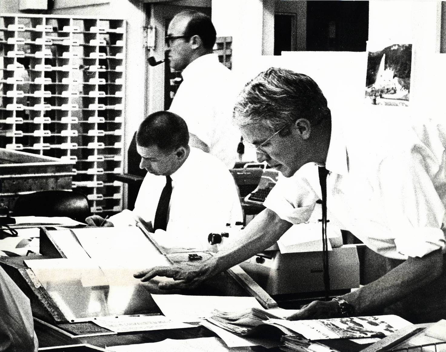 RFE COVERS THE MIDDLE EASET CRISIS -- At work in RFE's Central News Room during the Arab-Israeli war: (from left) Editor Arthur Breslauer, Assistant NEws Director Tom Bodin and Deputy CNR Chief Brian McGill. June 1967.